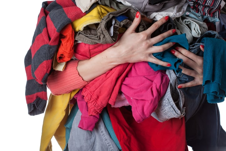pile-of-clothes-carrying-460589747-min